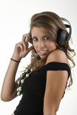 Beautiful girl to enjoy music — Stock Photo