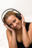 Girl listening to music with headphones — Stok fotoğraf