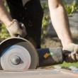 closeup worker with angle grinder — Stock Photo