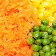 Boiled diced vegetables background with carrot, corn and peas — Stock Photo