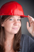 Portrait of young architect wearing red hardhat — Stock Photo