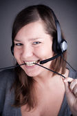 Studio picture from a young and beautiful callcenter agent — Stock Photo