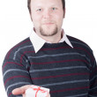 Royalty-Free Stock Photo: Young man holding valentine gift in his hand. He is giving it so