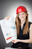 Young Design Engineer Woman Shows a Screwdriver Design Plan — Stock Photo