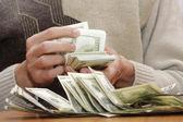 Cash dollars in hands — Stock Photo