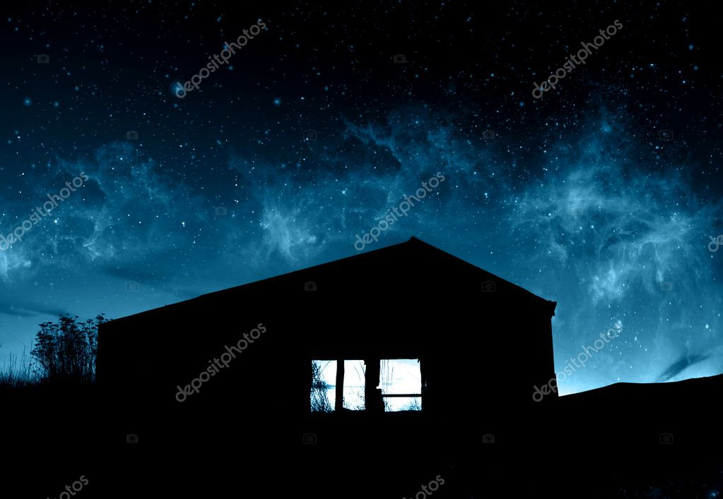Supernatural Concept - Silhouette of farmhouse in front of abstract blue sky  Stock Photo #5238823