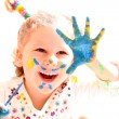 Girl with paint hands isolated on white - Stock Photo