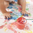 Baby and paint - Stock Photo