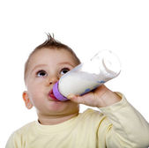 Baby is drinking milk — Stock Photo