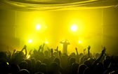 Underground club music concert with yellow lights — Stock Photo