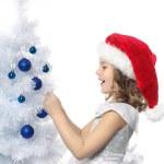Girl decorating christmas tree — Stock Photo #4438134