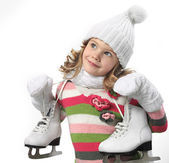 Girl in winter clothes with figure skates — Stok fotoğraf