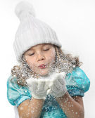 Girl blowing snow — Stock Photo
