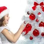 Girl decorating christmas tree — Stock Photo #4466728