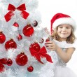 Royalty-Free Stock Photo: Girl decorating christmas tree