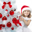 Girl decorating christmas tree — Stock Photo #4466739