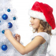 Girl decorating christmas tree — Stock Photo #4466819