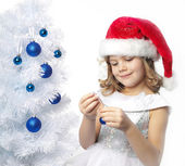 Girl decorating christmas tree — Stock Photo