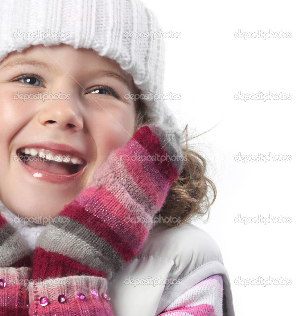 Cute little girl in warm clothes on white background — Stock Photo #4466800