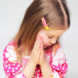 Portrait of young praying girl - Stock Photo