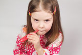 Young beautiful girl holding a red thermometer — Stock Photo