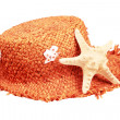 Straw hat and starfish isolated on a white background — Stock Photo #5276268