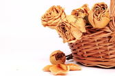 Dried yellow roses in a basket — Stock Photo