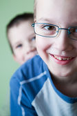 Two little brothers happy together (shallow DOF; color toned ima — Stock Photo
