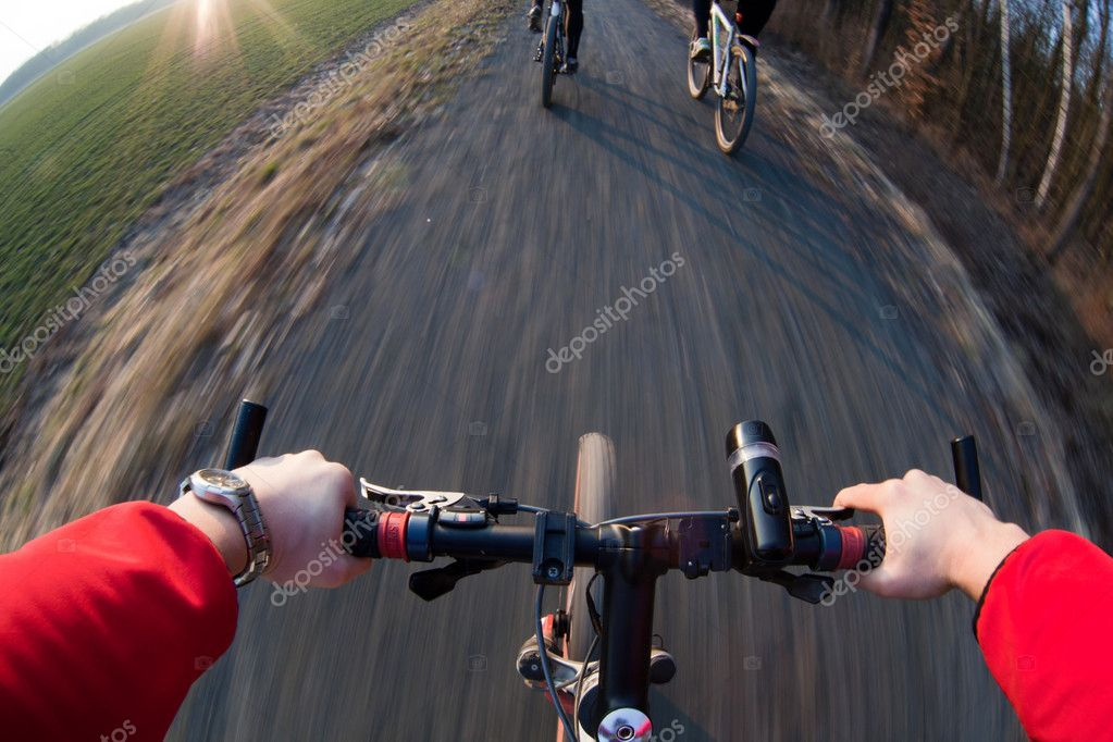 Riding a mountain bicycle on a country road (motion blurred image)  Stock Photo #4677564