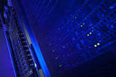 Server rack cluster in a data center (shallow DOF; color toned i — Stock Photo