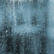 Stock Photo: RAIN DROPS ON THE WINDOWPANE