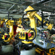 Welding robots in a car manufactory — Stock Photo #4445339