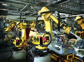 Welding robots in a car manufactory — Stock Photo