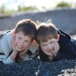Two boys laying on a beach — Stock Photo #4469079