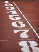 Finish line with numbers on a race track — Stock Photo