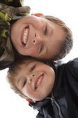 Two cute young boys with a teethy smile — Stock Photo
