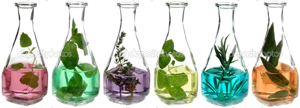 Different herbs in glass bottles with coloured liquid — Stock Photo #4469608
