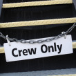 Crew only sign on a chain loking stairs — Stock Photo