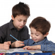 Stock Photo: Two young boys learning