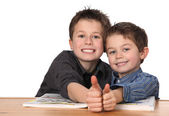 Two young boys learning — Stockfoto