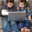 Boys with computer — Stock Photo
