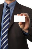 Blank business card in a hand — Stock Photo