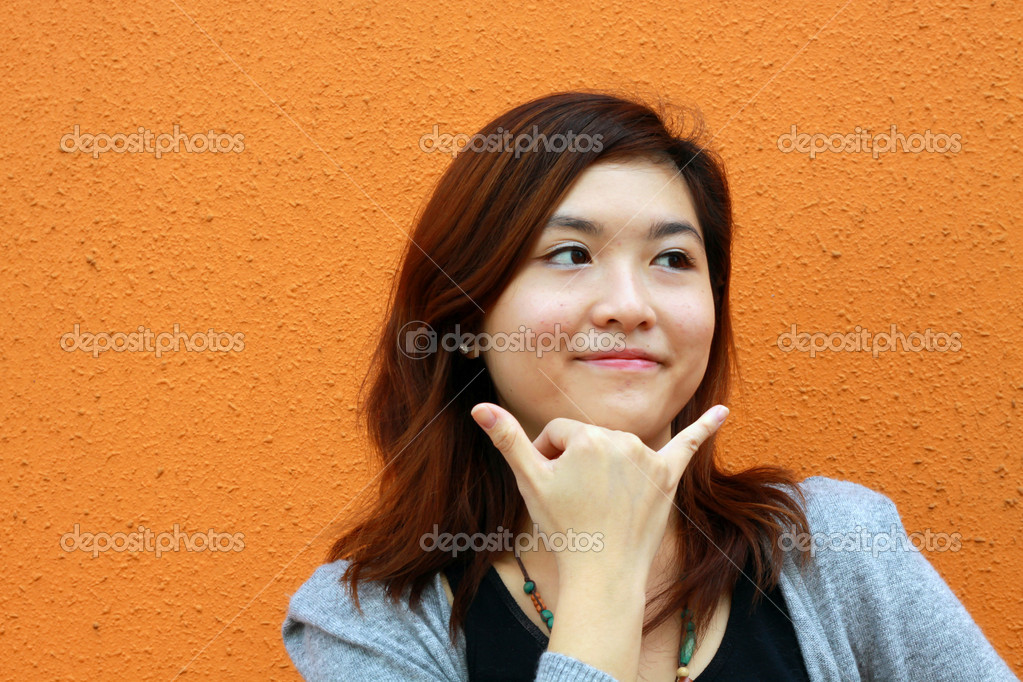She is smiling with her hands.  — Stock Photo #4490251