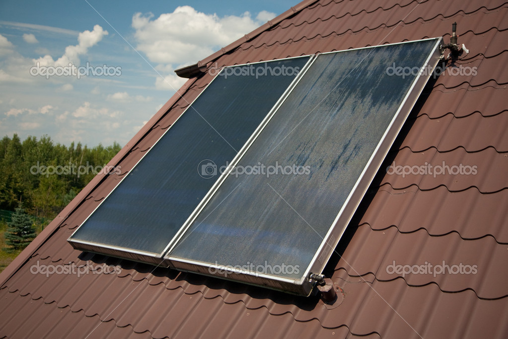 Flat-plate solar collector on roof in summer  Stock Photo #4487233