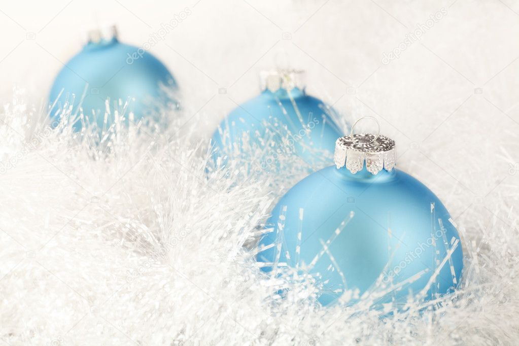 Three powder blue Christmas decorations on a white garland. — Stock Photo #4741804
