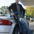 Young man at gas station — Stock Photo