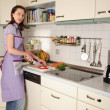 Housewife in her kitchen - Stock Photo