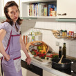 Housewife in her kitchen — Stock Photo #4469990