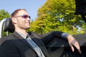 Adam ve onun spor araba — Stok fotoğraf