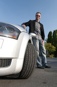 Man and his sports car — Stock Photo